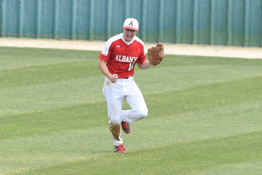 Albany's B.J. Morris (12) celebrates catching the final out of Game 2 of the Region I-2A series against New Deal.
