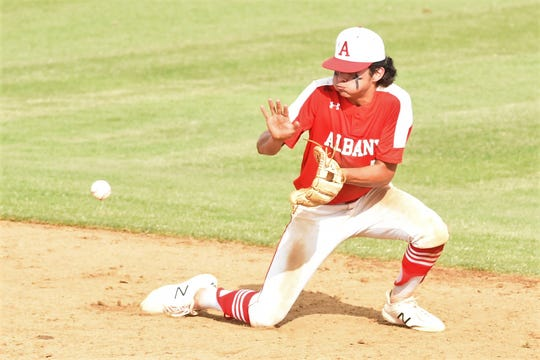 Albany second baseman Ben West (5) adjusts to a bad hop on a grounder against New Deal in Game 3 of the Region I-2A final series at Moffett Field on Friday, May 31.