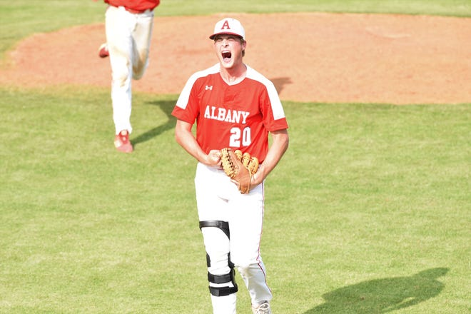 Albany pitcher Ryan Hill (20) lets out a yell after keeping the game tied in the top of the seventh inning against New Deal in Game 3 of the Region I-2A final series at Moffett Field in Snyder on Friday, May 31, 2019. Albany won the series 2-1 to reach the state tournament for the second time in three years.