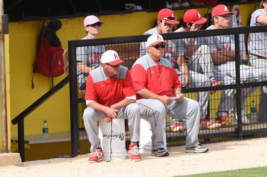 Albany head coach David Fairchild, left, and assistant Denney Faith watch Game 1 of the Region I-2A final series against New Deal at Moffett Field in Snyder on Thursday, May 30, 2019. Albany lost 8-0, but came back to win the series and advance to state for the second time in three years.