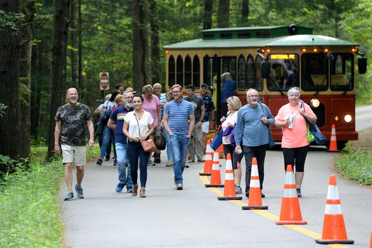 Visitors unload from trolleys and find a space along trails at the Elkmont Campground in the Great Smoky Mountains National Park to view the synchronous fireflies on June 3, 2019. Between 980 and 1100 come to the campground to watch the phenomenon each night of the 8-day mating period.