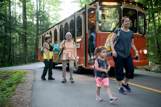 Visitors unload from trolleys and find a space along trails at the Elkmont Campground in the Great Smoky Mountains National Park to view the synchronous fireflies on June 3, 2019. The Smokies, the most visited park in the National Park Service, will send law enforcement rangers to assist in the Department of Interior-Border Patrol surge on the U.S.-Mexico border in FY 2020.