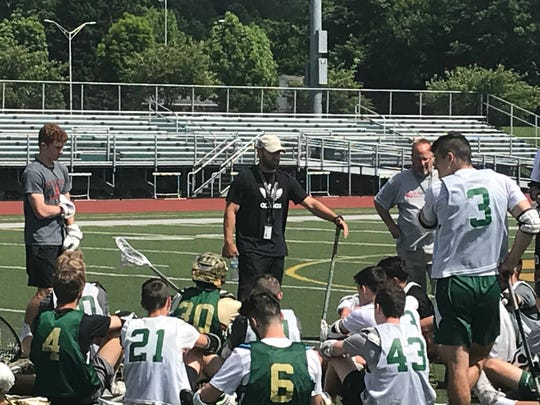 Vestal coach Chris Dutkowsky addresses his team before a practice Monday at Dick Hoover Stadium. The Golden Bears will play a Class B state semifinal at 6:30 p.m. Wednesday against Victor at St. John Fisher.