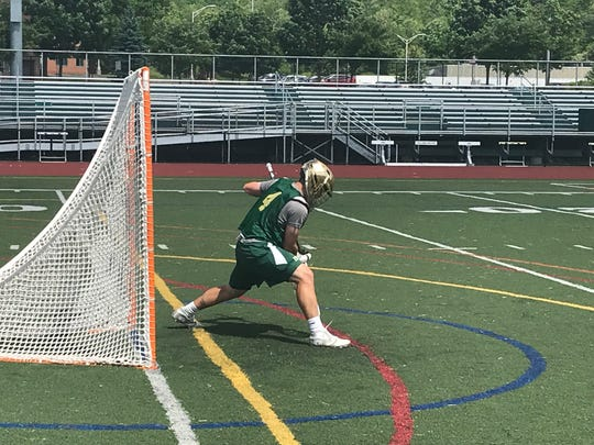 Vestal goalie Luke Barney stops a shot during practice Monday at Dick Hoover Stadium. Barney and the Golden Bears will play Victor in a state semifinal at 6:30 p.m. Wednesday at St. John Fisher.