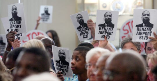 Supporters hold up signs during an April 2006 Melbourne City Council special meeting on renaming Airport Boulevard for Dr. Martin Luther King Jr. The ordinance failed by a 5-2 vote.
