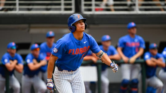 Florida's Brady McConnell watches his hit during an NCAA college baseball game against Georgia, Sunday, May 5, 2019, in Athens, Ga. (AP Photo/John Amis)
