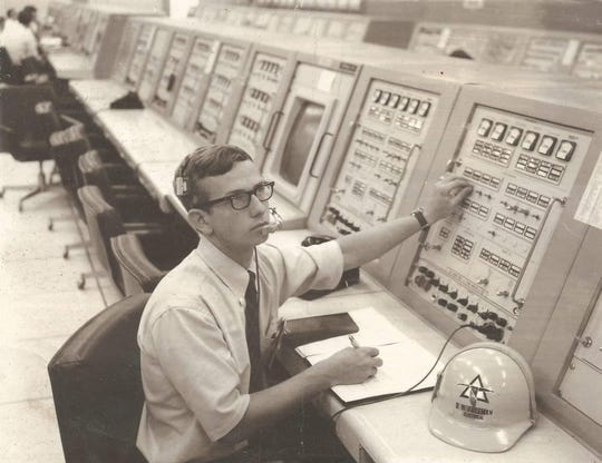 Bob Freeman seen sitting at his console in the launch control center in 1969.