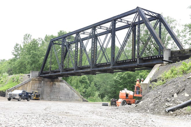 Norfolk Southern Railway work at the bridge site Tuesday afternoon.
