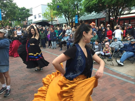 Dancers twirl during the concert by Mal Maiz on the Church Street Marketplace during the Burlington Discover Jazz Festival on June 4, 2019.