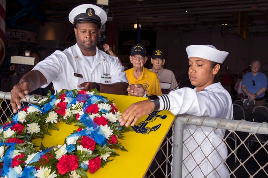 Senior Chief Petty Officer Larry Pugh (left) and Petty Officer 3rd Class Ashley Natali release a wreath into the Corpus Christi Bay during a Commemoration of the Battle of Midway and of D-Day ceremony at the USS Lexington Museum on the Bay on Tuesday, June 4, 2019. This year the event was hosted by Naval Air Station Kingsville. Each year it rotates between the two local bases.