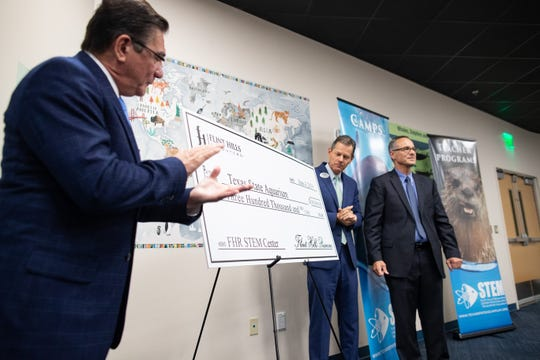 Andy Saenz and Brook Vicery of Flint Hills Resources presents the Texas State Aquarium with a three hundred thousand dollars on Tuesday, June 4, 2019.