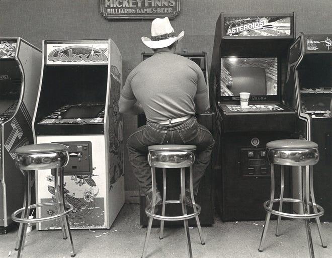 Jaime Ochoa plays a video game at Mickey Finn's in Corpus Christi in 1981.