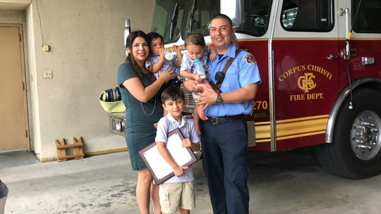 Lisa Naranjo, twins Maddox and Mateo and Mason pose for a photo with Corpus Christi Firefighter/EMT Raymond Naranjo. Raymond Naranjo, a Robstown native, received the Corpus Christi Medical Center's EMS of the Year - Brilliant Star of Life Award on Tuesday, June 4, 2019.