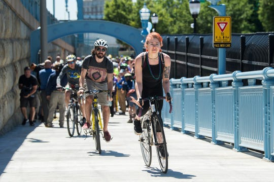 Bicyclists make their way up the new bicycle and pedestrian ramp, located at the south walkway of the Benjamin Franklin Bridge in Camden, following a ribbon cutting ceremony held to officially open the ramp on Tuesday, June 4, 2019.