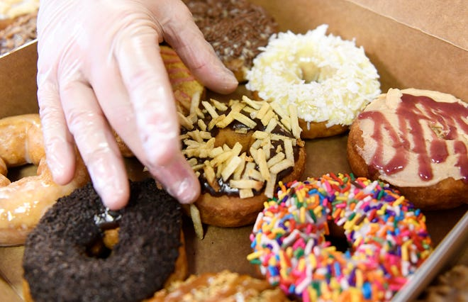 Tammy Buntz, owner of Mama Buntz's Donut Co. in Gloucester County, preps her special hand dipped, made to order donuts, for the day's customers. Her store is located on 421 Hurffville - Cross Keys Road in Sewell, N.J.