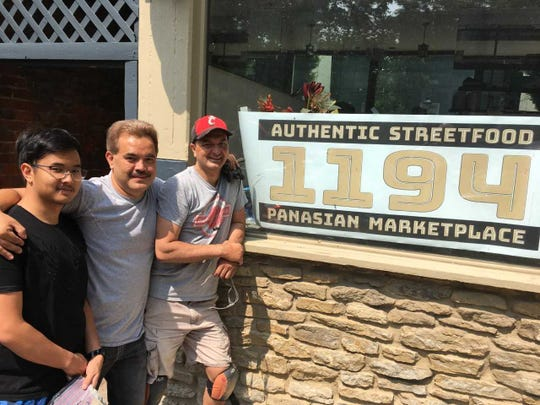 Bret Michaud, right, and his brother, Brian, center, were the original founders of Teak Thai Cuisine Bar in Mount Adams. They plan to open a new restaurant in the same space before the end of summer.