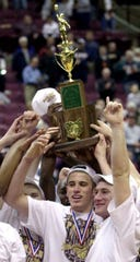 Members of the Roger Bacon basketball team hold their trophy up after winning the Ohio Boys Division II OHSAA Basketball Championship at Ohio States Value City Arena in Columbus. Roger Bacon beat Akron's St. Vincent-St. Mary Saturday March 23, 2002.