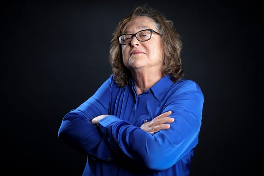 Enquirer dining writer Polly Campbell poses with her arms crossed, a cliche photo pose she's over, Tuesday, June 4, 2019, at The Cincinnati Enquirer.