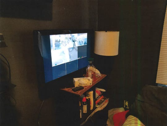 Part of the living room of Kirk Smith's house in Carthage, where near his bed was a television displaying images from his five surveillance cameras. The tissue box in front of the screen contained crack cocaine, police said.