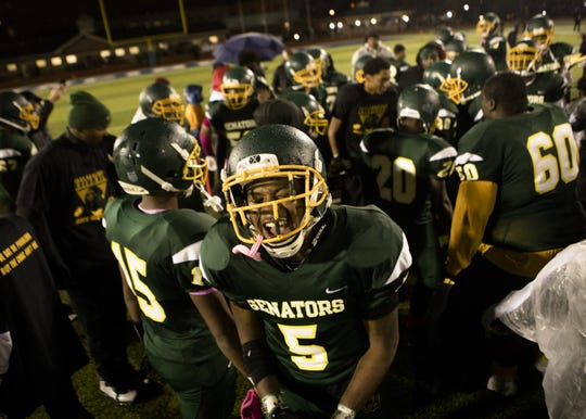 Taft's Ricold Moore (5) celebrates after the OHSAA final regular season game between Taft High School and Aiken High School on Friday, Oct. 26, 2018 at Stargel Stadium in the West End. Taft defeated Aiken 28-8.