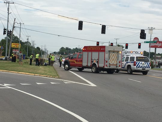 Crews work to save a man's life after a crash involving a motor scooter in a major intersection in Clarksville on Tuesdsay, June 4, 2019.