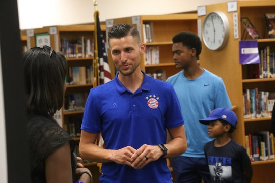 Michael Massie talks with parents and boosters at Clarksville High after being named the school's new head boys soccer coach Monday, June 3, 2019.