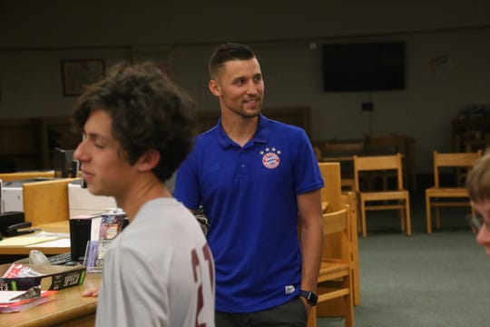 Michael Massie welcomes people as they arrive for the announcement that Massie will take over the head boys soccer coaching duties at Clarksville High, Monday, June 3, 2019.