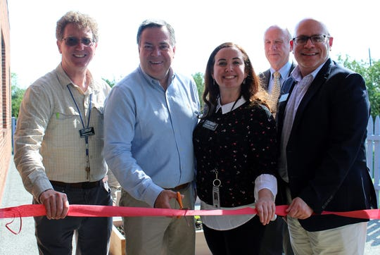Pictured are Branch Manager Ed Hoag; Bridgewater Mayor Dan Hayes; Youth Services Supervisor Meredith Hoyer; Councilman Allen Kurdyla; and Director of Public Services Christopher Korenowsky, celebrating the reveal of the Greany Learning Garden.