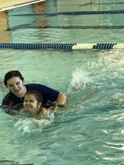 A South Amboy students practices some water safety skills at the South Amboy YMCA