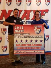 Susie Lavigne, 2018 AYC Coach of the Year, and Hunterdon Huskies Cheer Commissioner, accepts the academic awards on behalf of the Huskies D10 Cheer Team.