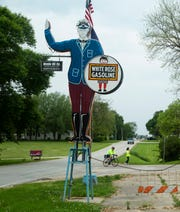 Riders on RAGBRAI's Pre-Ride roll into Menlo on their way to the day two end town of Winterset on Monday, June 3, 2019.