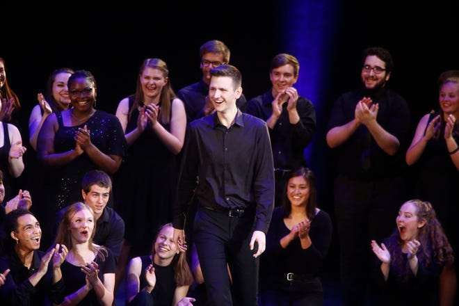 Triple Threat Award winner Cole Strelecki of West Des Moines Valley High School receives his award during the Iowa High School Musical Theater Awards Showcase on Monday at the Des Moines Civic Center.
