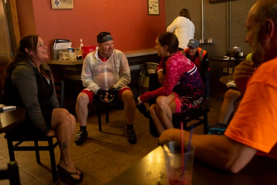 Then-RAGBRAI director T.J. Juskiewicz, center, and then-RAGBRAI staff member Andrea Parrott, center right, talk over plans with Earlham officials during RAGBRAI's pre-ride on Monday, June 3, 2019.