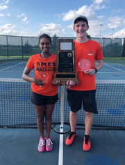 Ames' co-ed tennis team of Timothy Ellis and Arunadee Fernando pose after winning the state title.