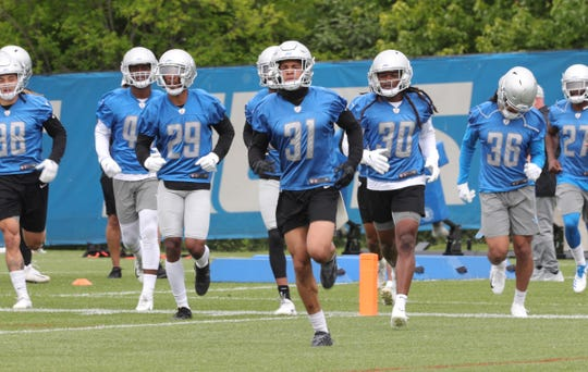 Lions defensive backs move to the next drill during minicamp on Tuesday, June 4, 2019, in Allen Park.