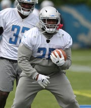 Lions running back C.J. Anderson goes through drills during minicamp on Tuesday, June 4, 2019, in Allen Park.
