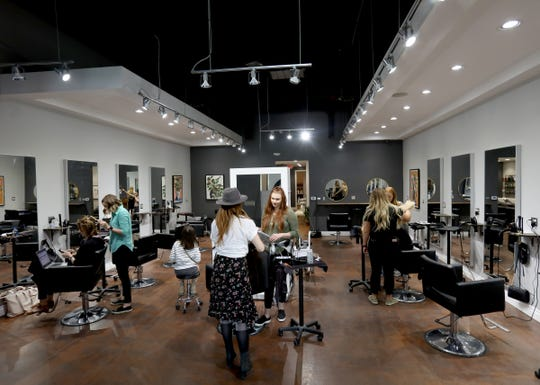 Work goes on at Aesthetic Hair Co. in Ferndale on  June 4, 2019. Alex Pardoe 25, co-owns the salon and advises hairdressers how to make more money. He encourages them to promote their work on Instagram.