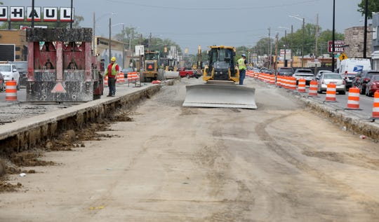 The median on Livernois along Detroit's Avenue of Fashion undergoes work that when finished will have bike lanes going in both directions.