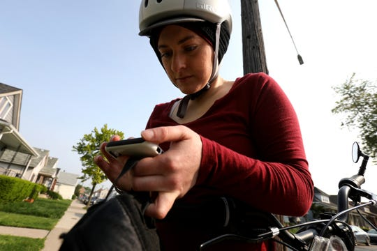 Amanda Jaczkowski opens the MapMyRide app on her iPhone before heading out from her home in Hamtramck on her bike to a meeting in Detroit on May 31.