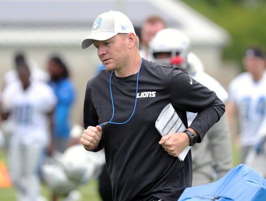 Lions offensive coordinator Darrell Bevell runs off the field after minicamp on Tuesday, June 4, 2019, in Allen Park.