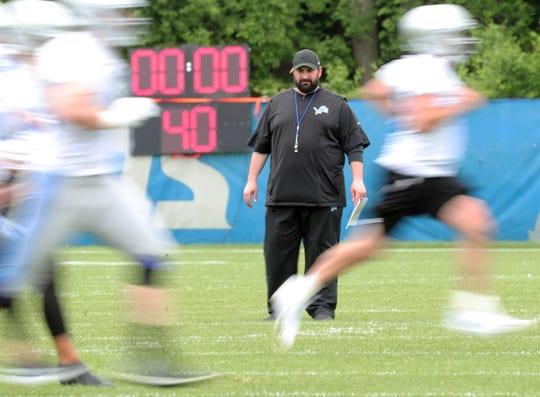 Lions coach Matt Patricia watches players run after minicamp on June 4, in Allen Park.