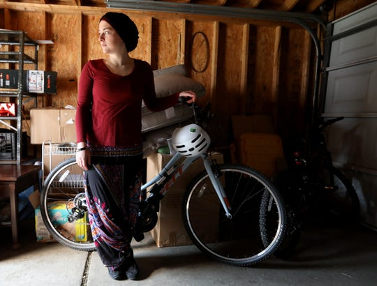 Amanda Jaczkowski in her garage before heading out from her home in Hamtramck on her bike to a meeting in Detroit in late May.