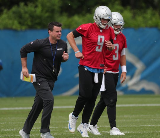 Lions quarterbacks coach Sean Ryan and quarterbacks Matthew Stafford and Tom Savage run to the next drill during minicamp on Tuesday, June 4, 2019, in Allen Park.