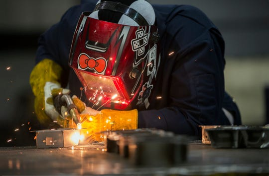 Fredrea Lakes, 29, of Oak Park tack welds sub-assembly at the Armored Group  Group in Dearborn Heights on Monday, June 3, 2019.  Fredrea received a six-week free training course in welding as part of the Women Who Weld group before obtaining this job.