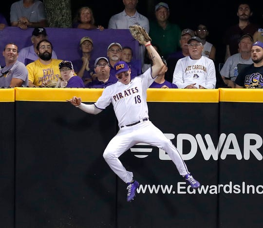 East Carolina's Bryant Packard makes the catch against the wall in the ninth inning during Quinnipiac's 5-4 victory over East Carolina during an NCAA college baseball tournament regional game Saturday, June 1, 2019, in  Greenville, N.C.
