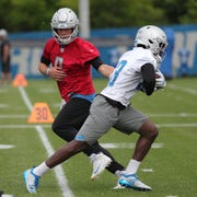 Lions quarterback Matthew Stafford hands off to running back Kerryon Johnson during minicamp on Tuesday, June 4, 2019, in Allen Park.