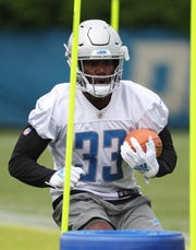Lions running back Kerryon Johnson goes through drills during minicamp on Tuesday, June 4, 2019, in Allen Park.