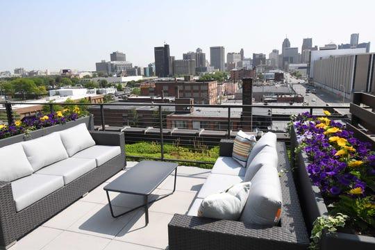 Fifth floor common area with outdoor terrace overlooking Detroit.