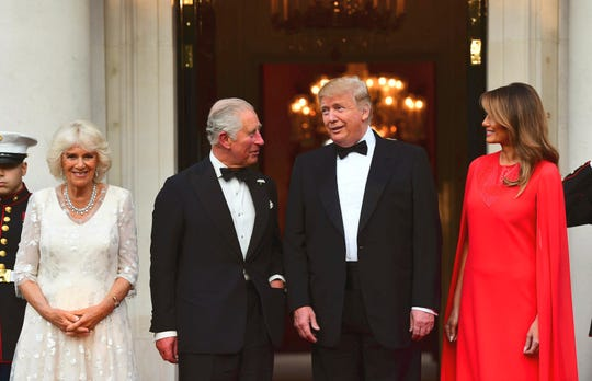 Britain's Prince Charles, center left and Camilla, the Duchess of Cornwall, left are greeted  by U.S. President Donald Trump and first lady Melania Trump, outside Winfield House, the residence of the Ambassador of the United States of America to the UK, in Regent's Park, London, for the Return Dinner as part of his state visit to the UK, Tuesday June 4, 2019.