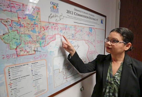 Orange County Commissioner Emily Bonilla looks at a map of Orange County and the city of Orlando in Orlando, Fla. Bonilla is worried her district in metro Orlando will be undercounted during next spring's once-in-a-decade head count of everybody in the United States because of who lives there: new arrivals, immigrants, the poor, renters and people living in rural areas who sometimes regard government with suspicion.